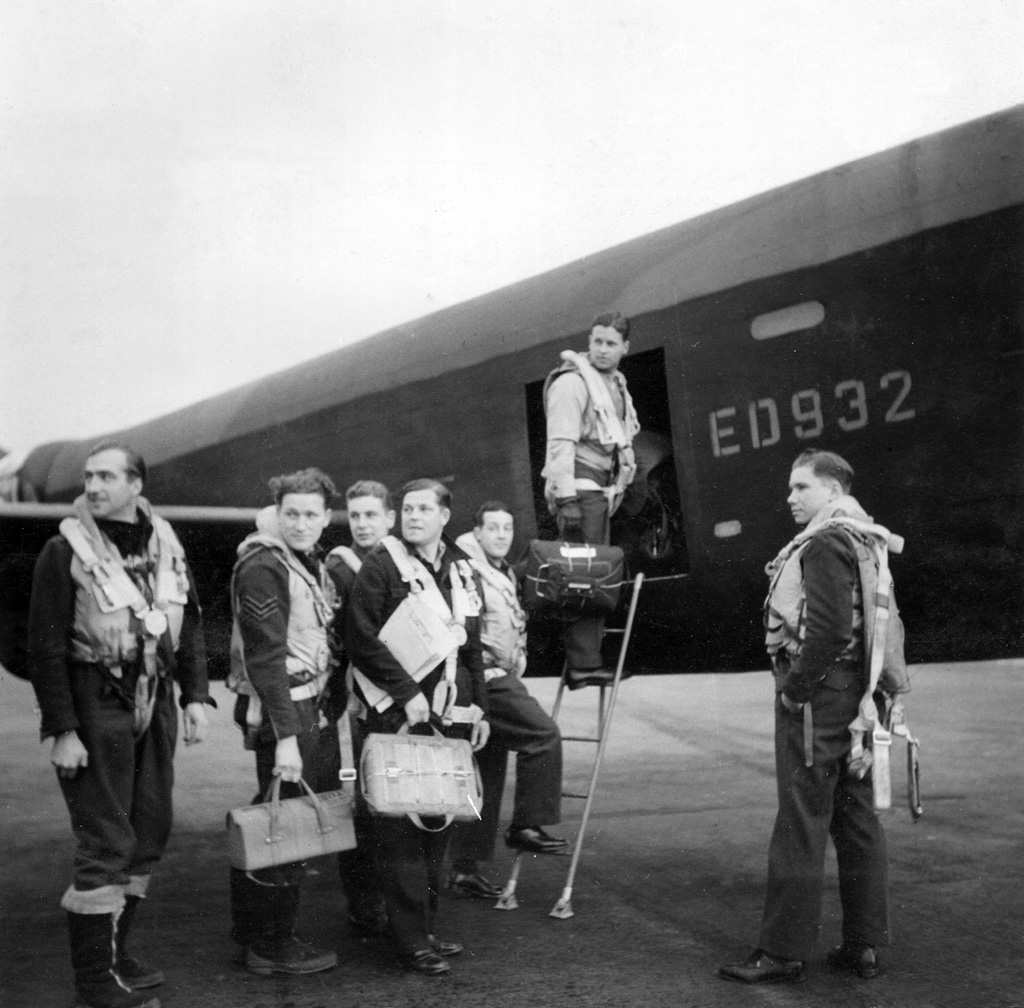Leader of the Dambusters Raid, Wing Commander Guy Gibson, seen with his crew as they board their Avro Lancaster III ED932/AJ-G for the Dams' Raid of 16/17 May 1943. L-R: Flight Lieutenant RD Trevor-Roper, Sergeant J Pulford, Flight Sergeant GA Deering (Canadian), Pilot Officer FM Spafford (Australian), Flight Lieutenant REG Hutchison, Wing Commander Guy Gibson, Pilot Officer HT Taerum (Canadian) © Crown Copyright