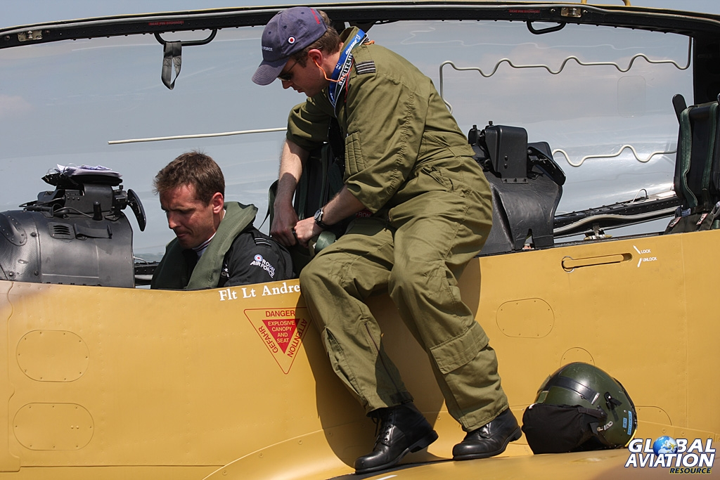 Jon was at RAF Waddington International Airshow in both 2012 and 2013, helping the team. Here he is strapping in Andrew Fyvie-Rae, the 2013 display pilot © Gareth Stringer - Global Aviation Resource